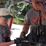 Papa and grandson Jonah working on a race car motor!